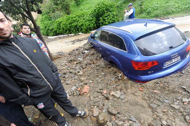Half Buried Car