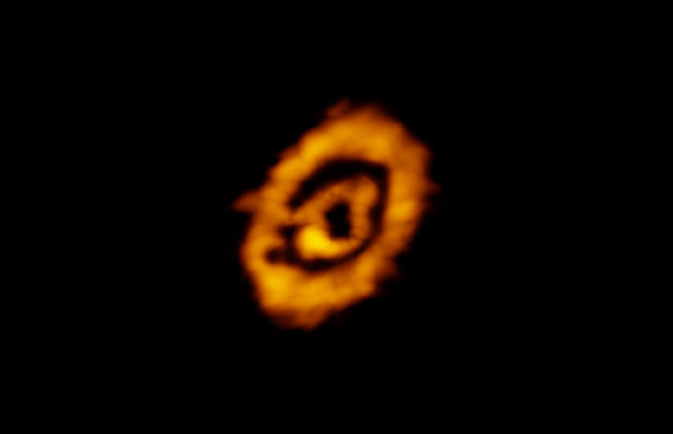 Dual rings of DCO+ encircling the star IM Lup